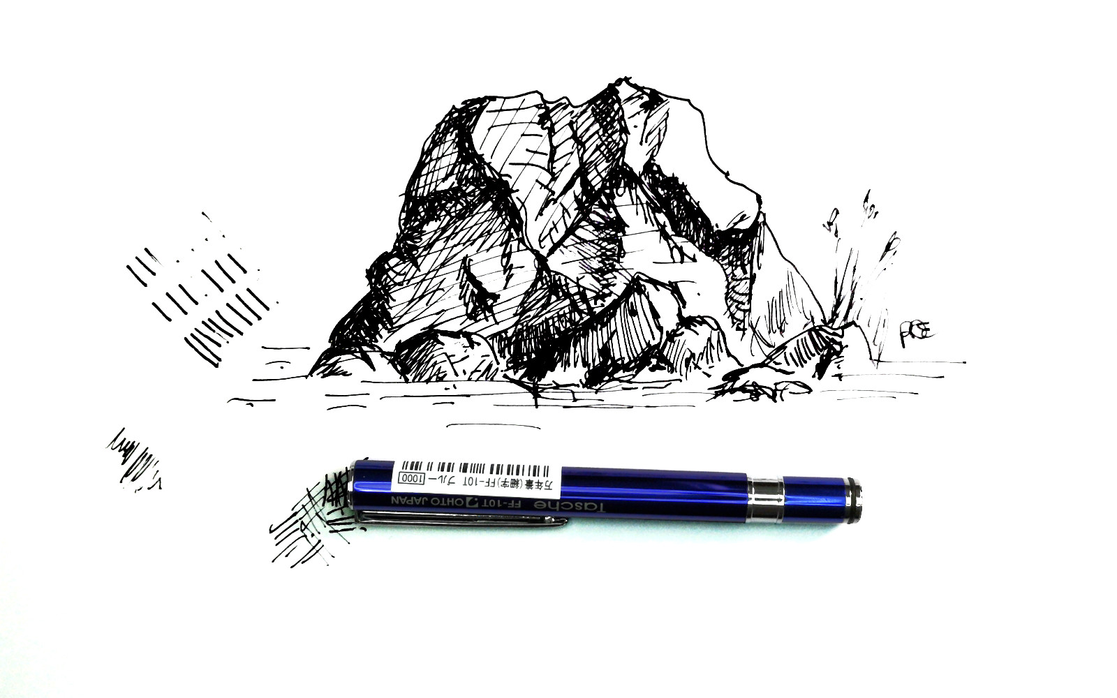 Rock doodled with the Ohto Tasche fountain pen